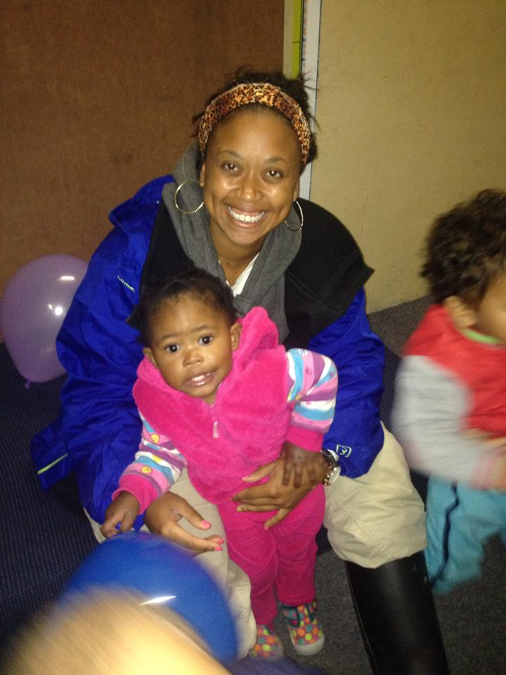 Washington with Mbesa, a child from the Cape Town day care who lit the desire in her to teach abroad.