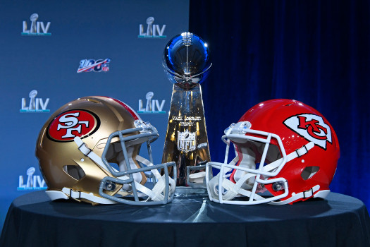 MIAMI, FL -  JANUARY 29: Photo of the Vince Lombardi Trophy presented next to the San Francisco 49ers and Kansas City Chiefs helmets during the NFL's annual Super Bowl press conference in Miami, Florida, on Wednesday, Jan. 29, 2020. The San Francisco 49ers will play the Kansas City Chiefs in Super Bowl LIV on February 2. (Jose Carlos Fajardo/Bay Area News Group)