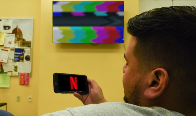 In this photo illustration a Netflix logo seen displayed on a smartphone