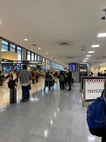 Passengers are seen wearing masks as a protective gear amid the COVID-19 pandemic at Narita International Airport, Tokyo, Japan.