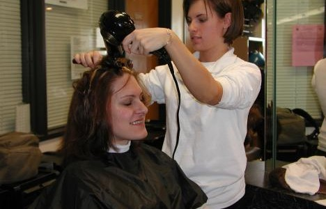 Cosmetology student Anna-Rose Aboud gives Katie Wallace an after-haircut blowdry. (Liezl Laurel)