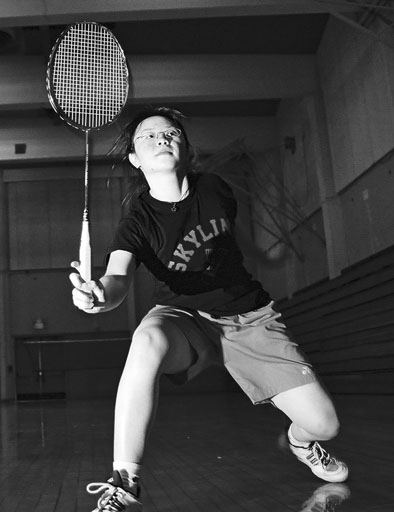 Stephanie Cheung, the top ranked community college badminton player in northern California,takes a swing during practice. (Neill Herbert)