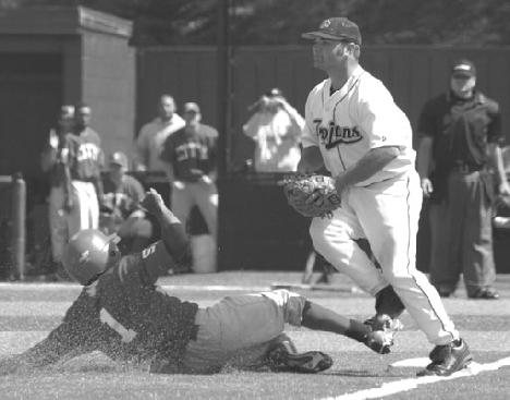 Third baseman Robert Hitchens beats a Cabrillo College player to the base, for the out on April 26.   (Bob Varner)