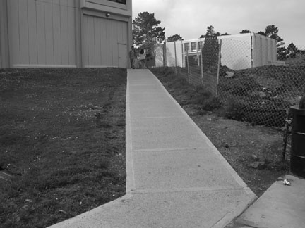 Ramp to Building 5 is not compliant with ADA regulations, although it was built in 2004. ()