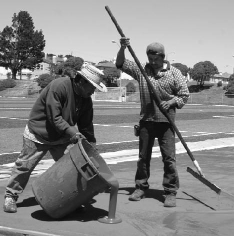 Two workers help resurface Skyline´s track after brutal weather. (Bob Varner)