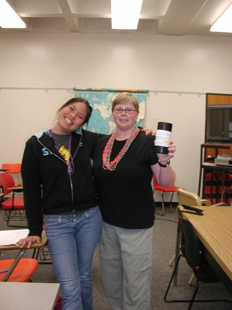 Angie Rayfield, vice president of scholarships from Phi Theta Kappa honor society poses with donation can and proud  hurricane relief donater Nikki Santiago. ()