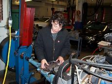 Photoed Julia Johnson meticulously working on an auto engine. (Courtesy of Julia Johnson)