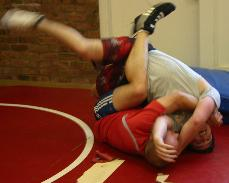 Coach James Haddon and Skyline wrestler Eric Helmstreit spar at practice. The team is recruiting athletes to wrestle at Skyline and help slam the team to success in the upcoming season.   ()