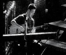 Mike Shinoda rockin' out at Projekt Revolution. ()