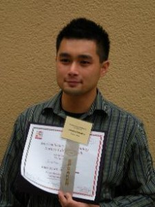 Tolentino holds up his first place award from the American Society of Micro-Biology (Jonathan Tolentino)