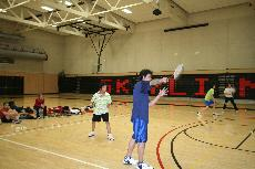 A Skyline student takes a practice swing in Badminton class while his teammate watches (Brenda Cancino)