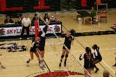 Skyline's player attempts to slam a spike past a Gavilan defender ()