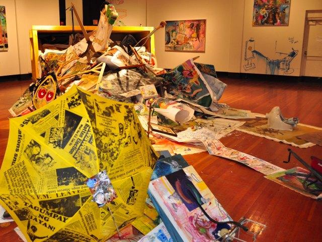 Found+objects+spill+out+of+the+dumpster+instalation%2C+including+a+unbrella+from+Manilla.+%28Milan+Subedi%2FThe+Skyine+View%29