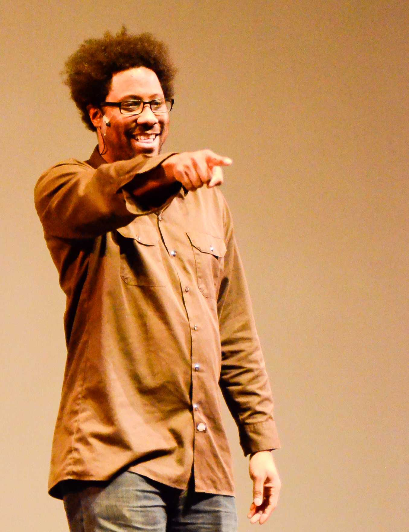 Comdian W. Kamau Bell points to the audience during his performance at Skyline College. (Robyn Graham)