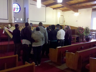 Acquaintances and friends gathered at St, John Missionary Baptist Church to pay their respects. (Marc Arguello)