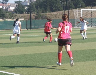 Trojans head for the goal in the game against Las Positas.
