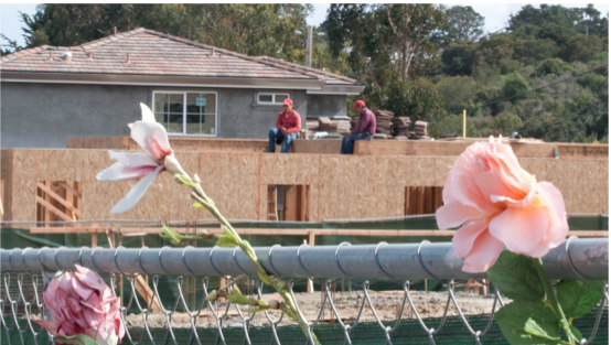Flowers adorn the chain-link fence around a home that was destroyed by the PG&E pipeline explosion on Sept. 9, 2010. (Will Nacouzi)