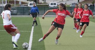 Trojans #9 Leila Torres (right) on the attack against Rams #7 Midfielder Crystal Zeledon (left).