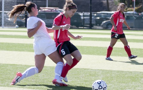 Skyline's Rasha Shehadeh (right) is aggressively tackled by a Las Positas midfielder during the Oct. 23 match. Shehadeh suffered a crushed nerve in her foot as a result.