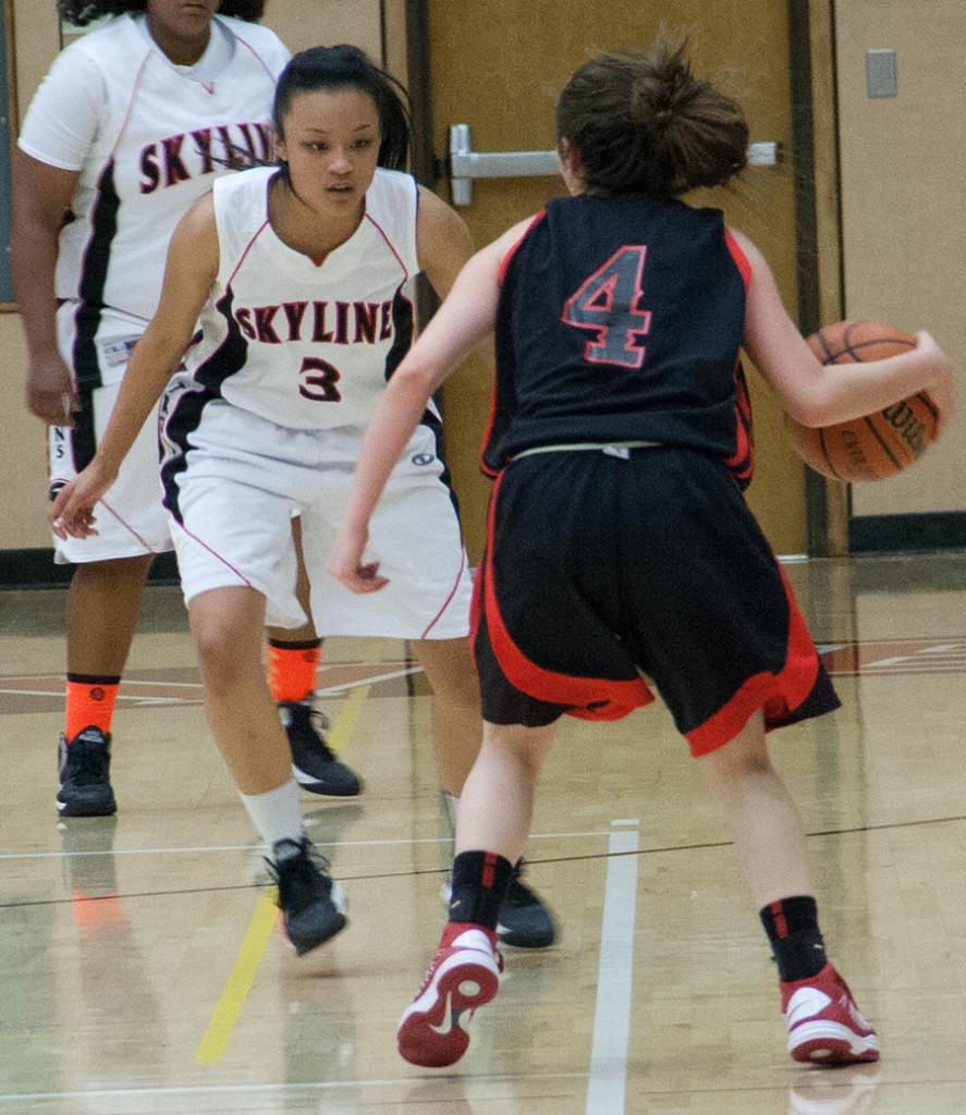 Trojans #3 Chanel Piper (left) and #4 Brianna Estrada (right) facing of each other during the first half of the game, Skyline College, building 6, gym, Wednesday, Feb.20, 2013. Skyline women's basketball team played against the Las Positas Hawks on the night of the 20th, their last home game of the season and finished the game with a loss 67-47.