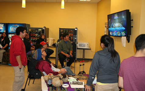 Students enjoy playing Super Smash Bros. with each other in the Student Lounge