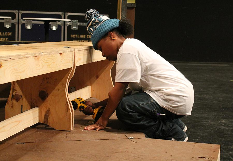 Taylor+Williams%2C+student+of+Skyline+College%2C+working+on+the+set+in+the+theater.+