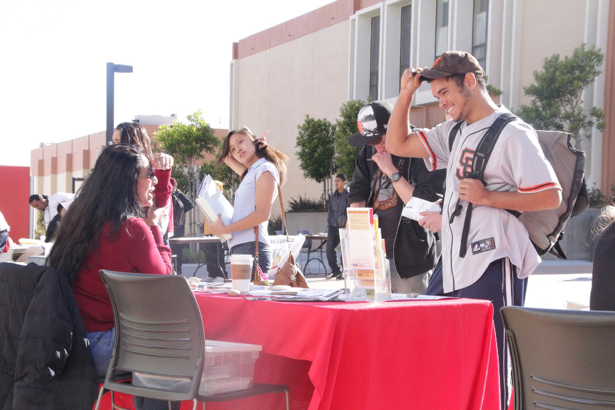 A member of the ASSC chats with a student during the club rush event.