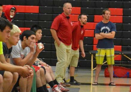 Coach Haddon (center) on the sidelines watching a match.