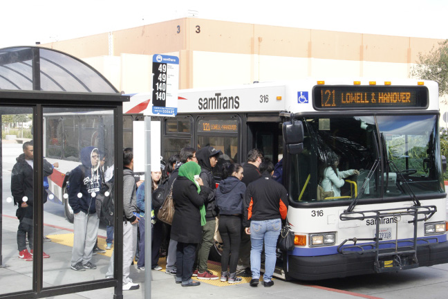 Students board a crowded bus after the alternative route had been discontinued.