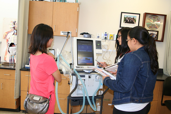 Rae De LaRosa (center) works in the respiratory therapy lab after class. The campus is exploring the idea of offering a bachelor's degree in respiratory therapy.