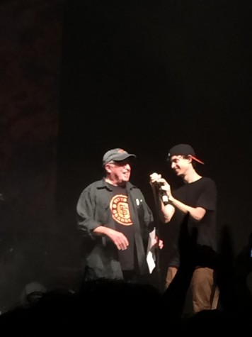 Watsky's father preparing to recite poetry halfway through his son's performance.