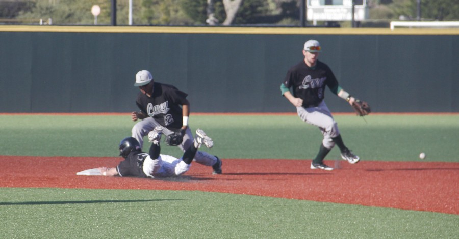 Phil Caulfield slides to second during the Trojan's opening game against Laney College on Feb. 29, 2015.
