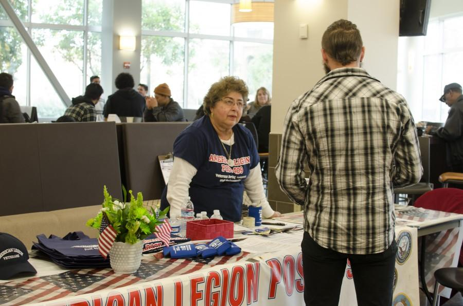 American+Legion+volunteer%2C+Ana+Garcia%2C+talks+to+a+Skyline+College+student+about+the+non-profit+organization%27s+services+and+programs+during+the+Veterans+Resource+Event+in+Skyline+College%27s+Fireside+Dining+Hall+on+Mar.+10%2C+2016.