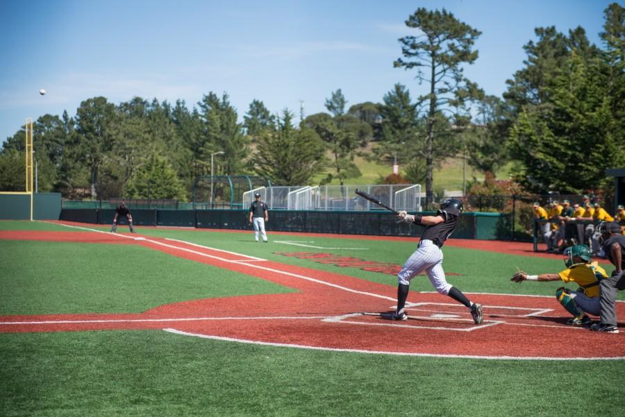 Skyline Trojan Matt Seubert hits a fly ball out to left field in the first inning against the Cañada Colts at Skyline College on Tuesday, April 5, 2016.