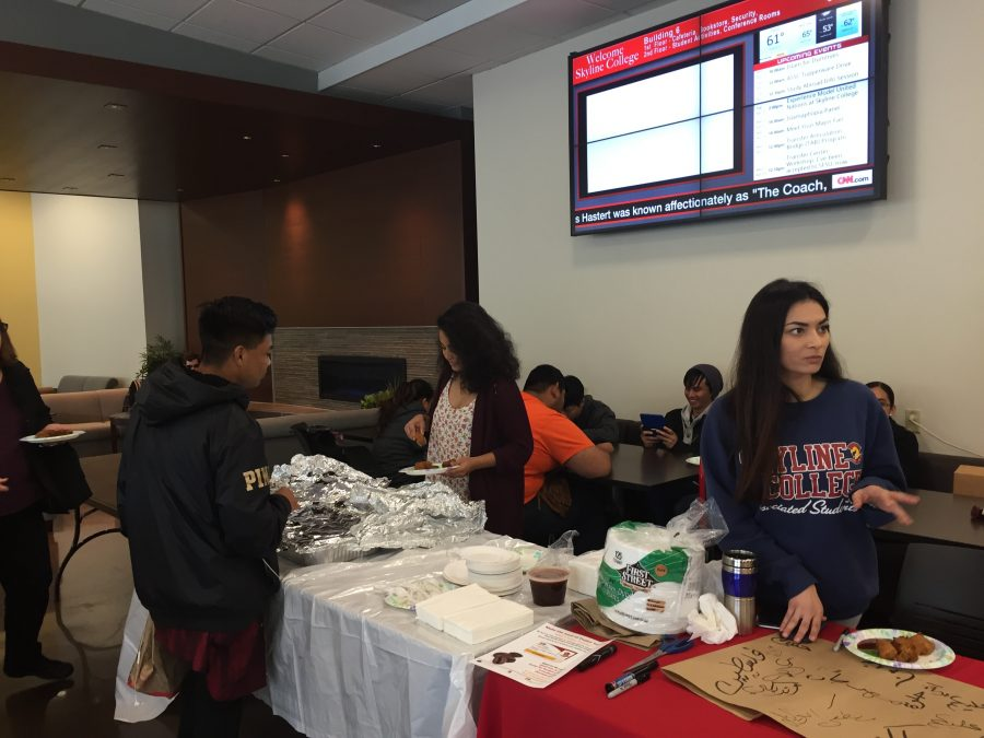 Skyline students Nena Darwin and Khin Thar are serving Halal food in the Fireside Room in building six on April 11 during the Islam 101 event to students.