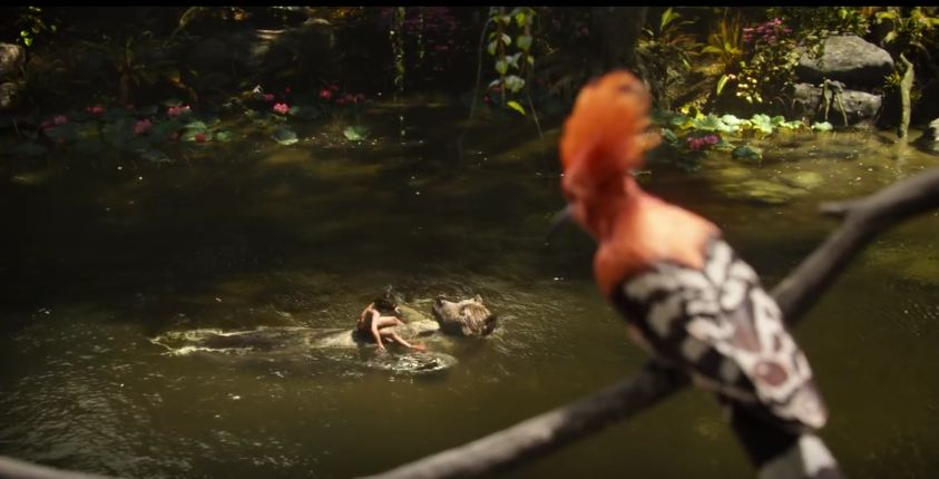 A screenshot of Mowgli and Baloo floating along the river singing