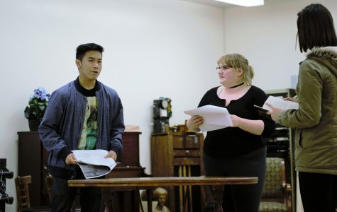 "Cast members rehearse lines for upcoming play ""Middletown""."