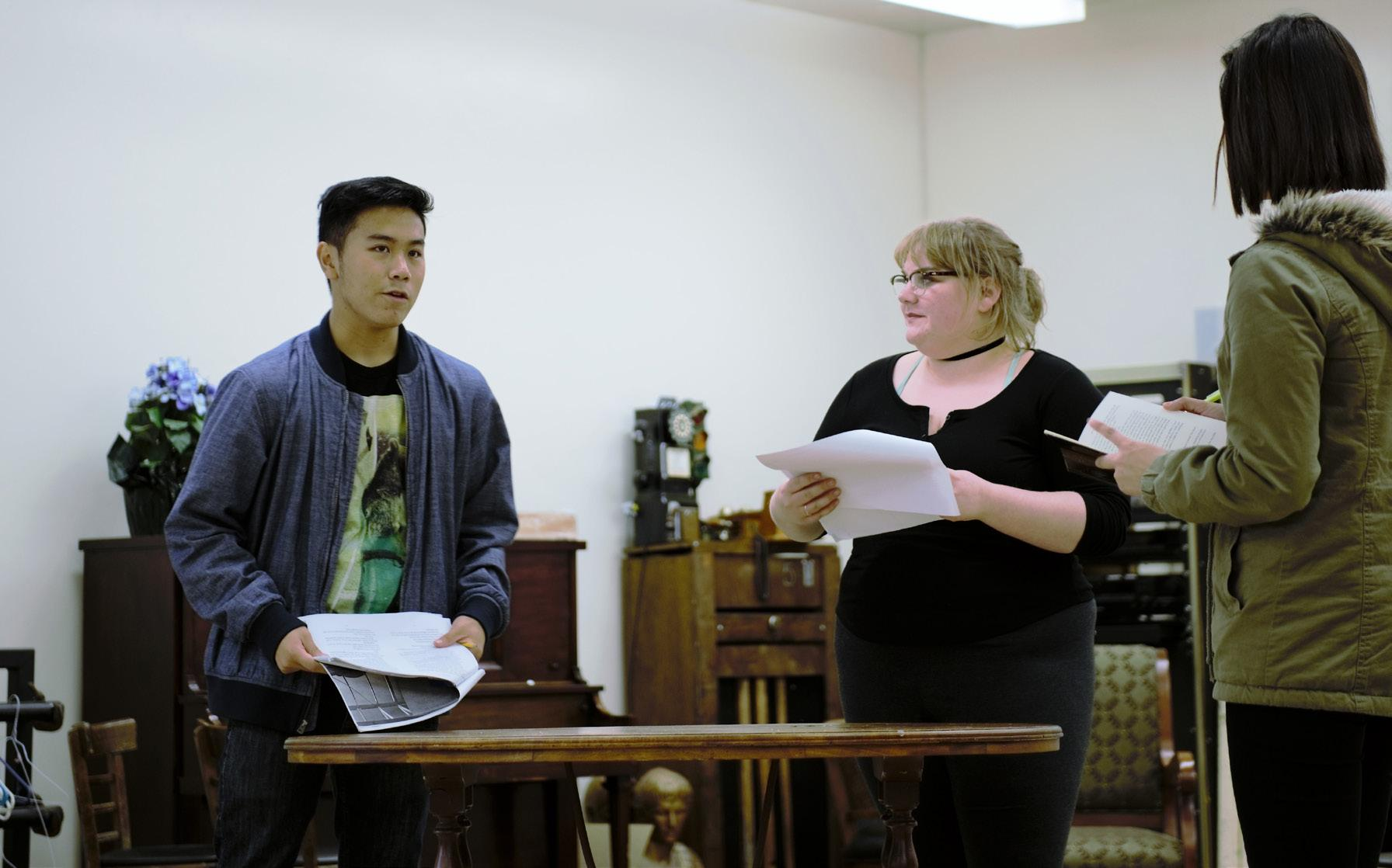 """Cast members rehearse lines for upcoming play """"Middletown""""."""
