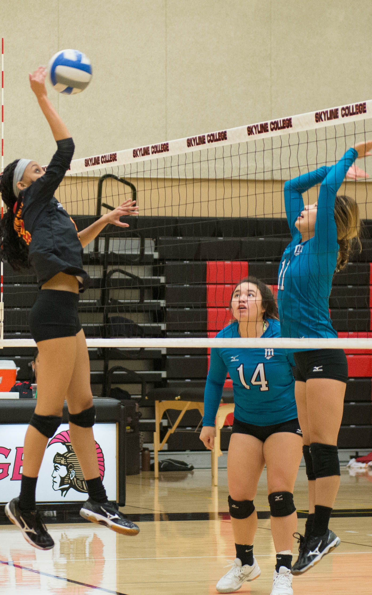 Raja Elliot spikes the ball against Mission College's Mege Gomez on Nov. 4.