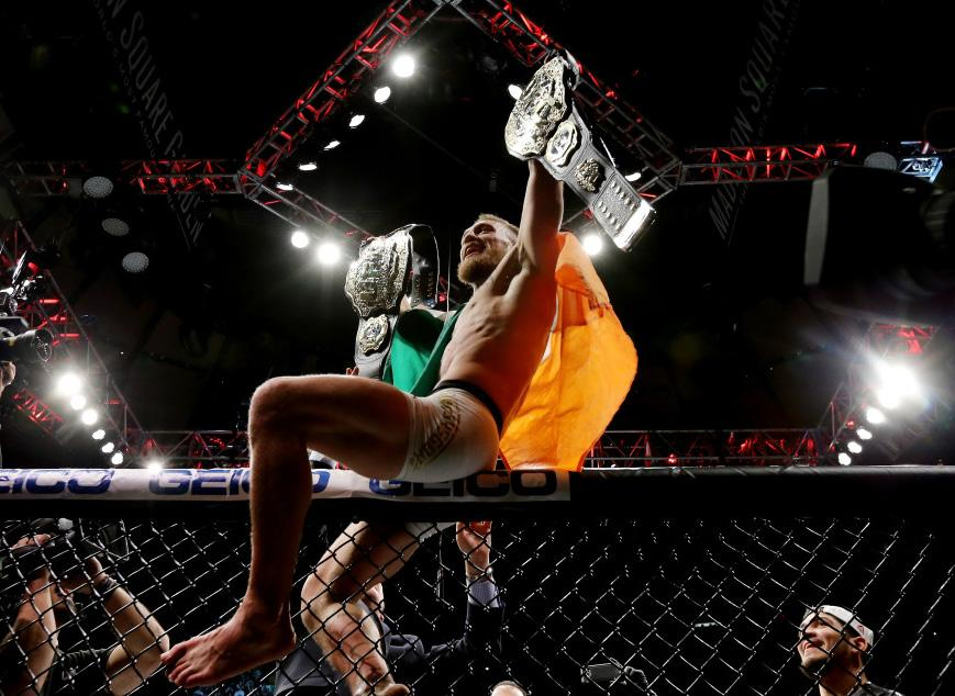 Conor+McGregor+of+Ireland+celebrates+his+KO+victory+over+Eddie+Alvarez+of+the+United+States+in+their+lightweight+championship+November+12%2C+2016+in+New+York+City.