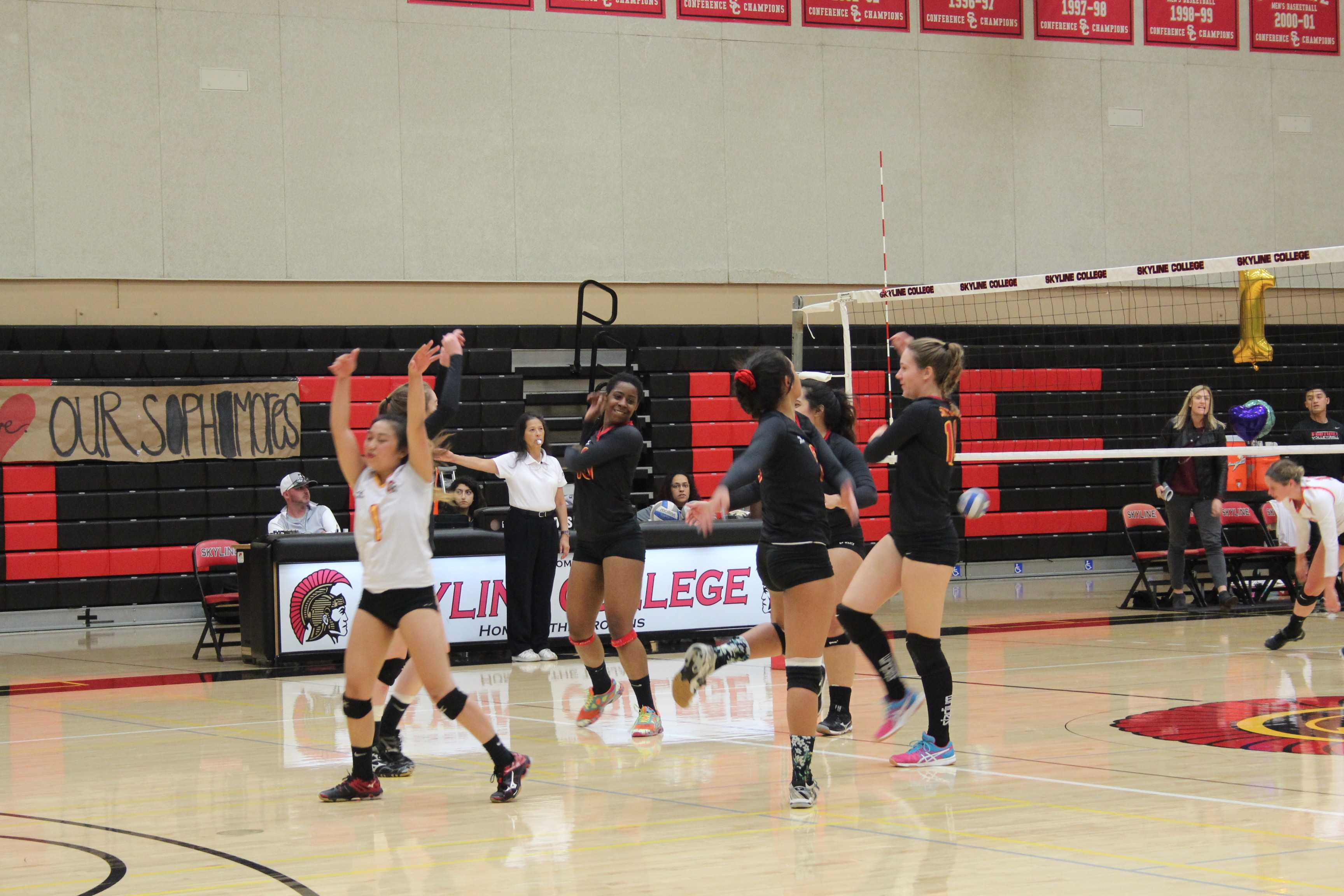 The team celebrates as a group after a score against Foothill College on Nov. 23, 2016.