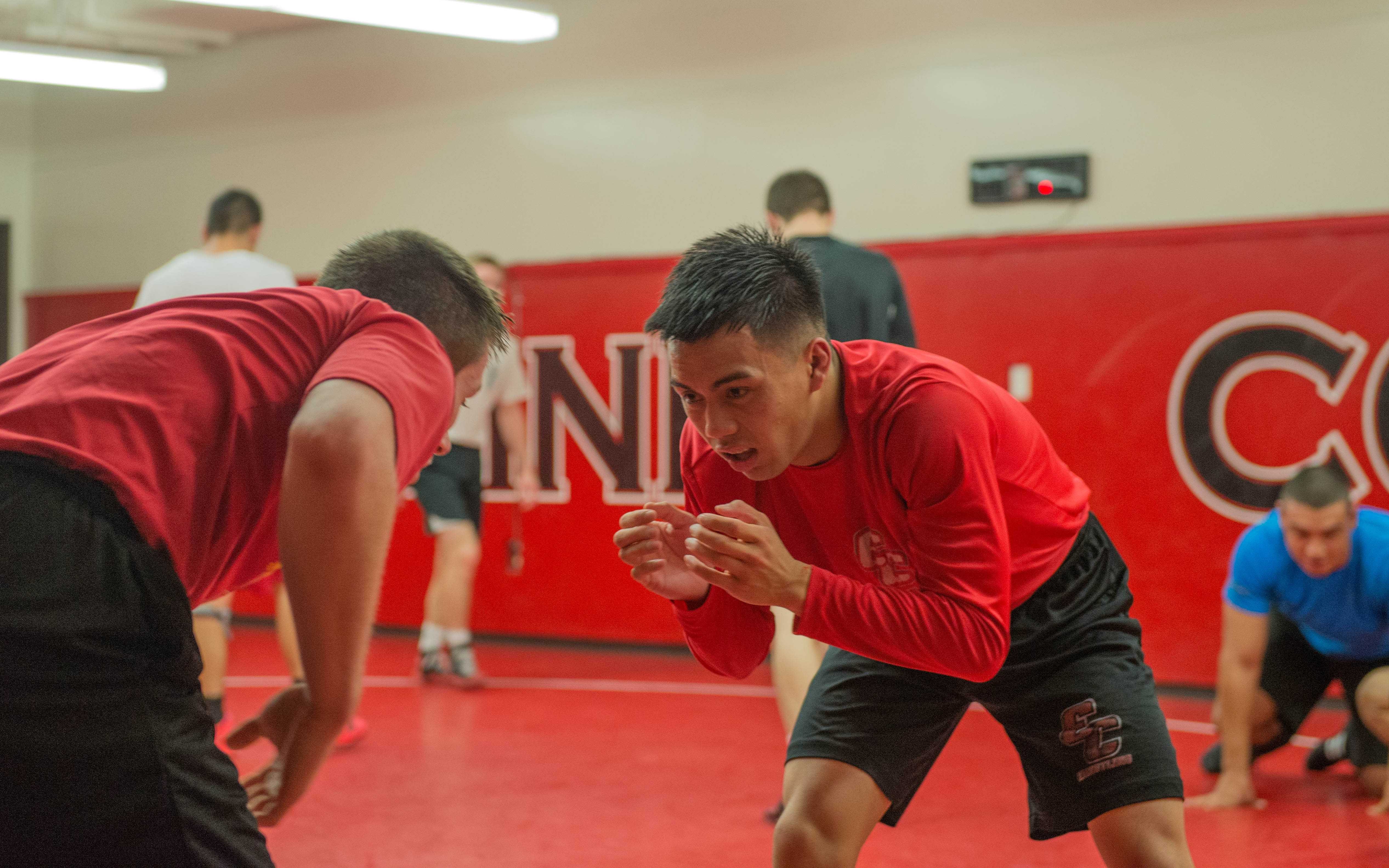 Aaron Aquino and Tanner Robson drill takedowns during practice on Nov. 29, 2016.