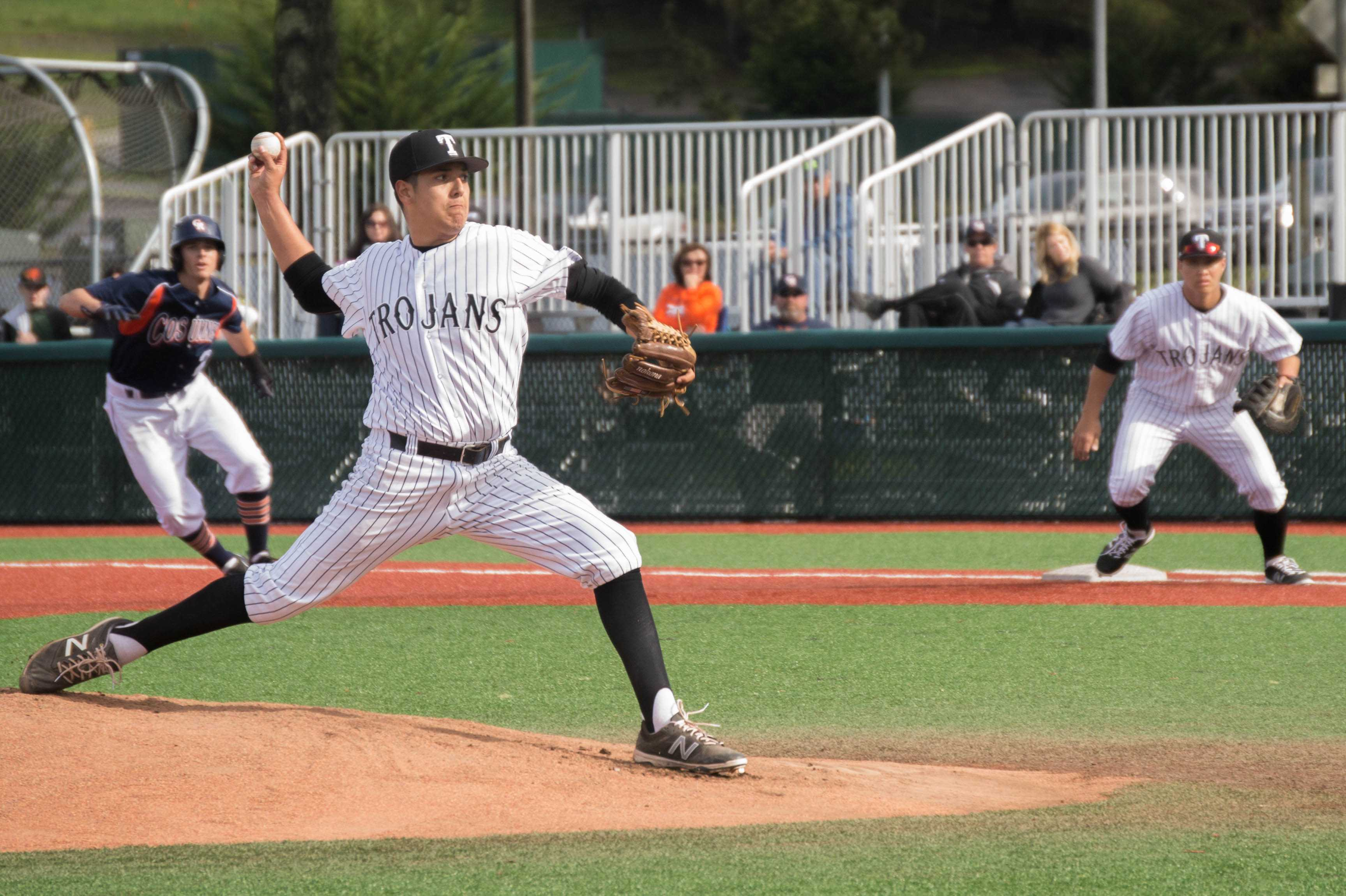 Ray Falk pitches the ball against Cosumnes River College on Feb. 4, at Skyline College.
