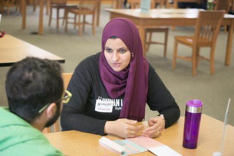 Khaoula Aissaoui and a student talking at one of the tables available at the Human Library event.