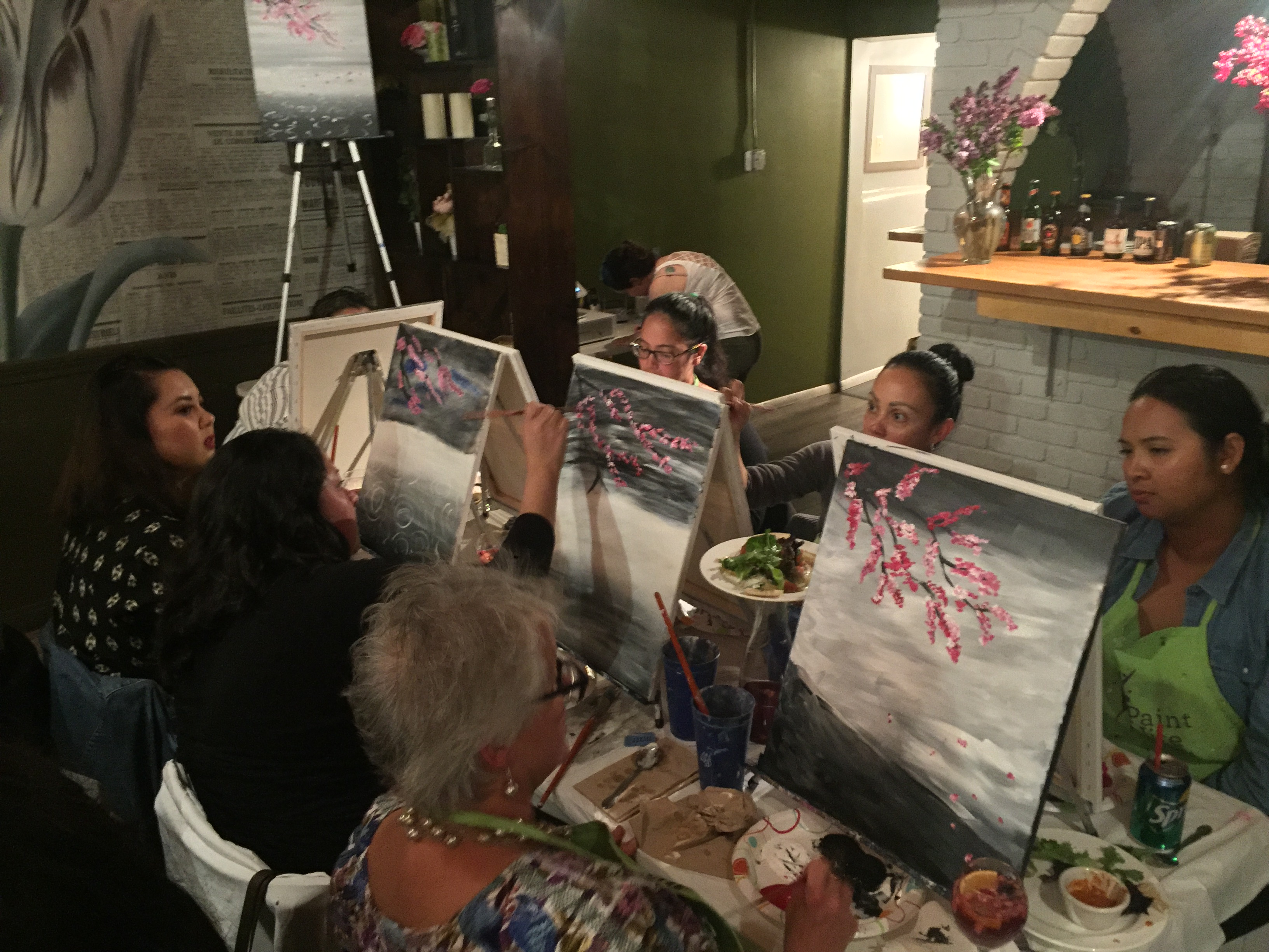 Participants at Paint Nite enjoyed a meal while painting at LaLe restaurant in San Francisco on April 12, 2017. Photo credit: Mintzhet Tan