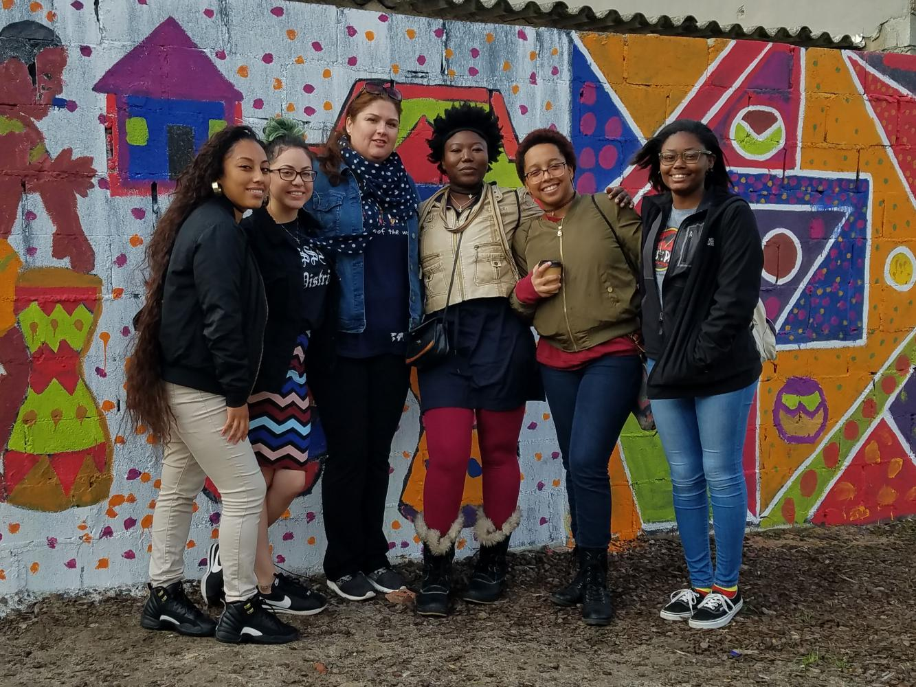 Skyline students from the Women's Mentorship and Leadership Academy strike a pose on a trip to South Africa.