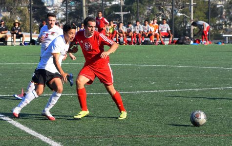 Isai Flores and a City College of San Francisco defender compete for control of the ball.