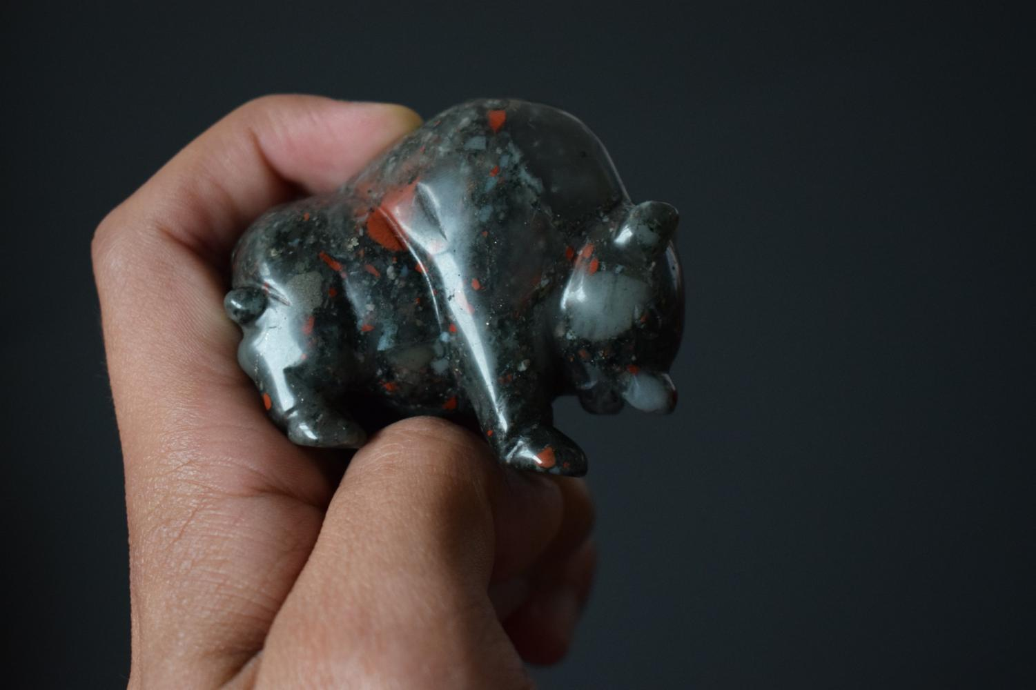 A carved buffalo made from heliotrope jasper being held on Nov. 8, 2017.