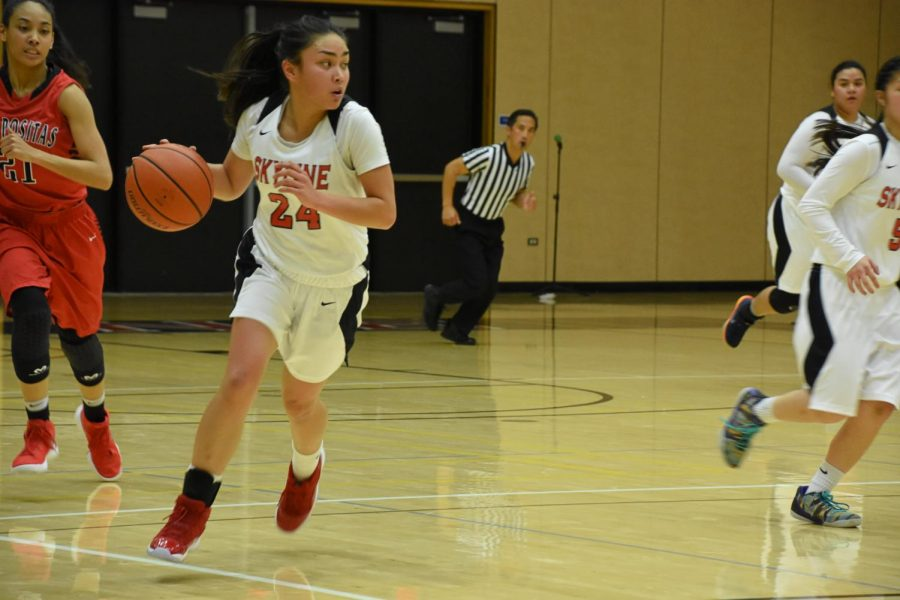 Giselle Mahinay driving the ball forward.