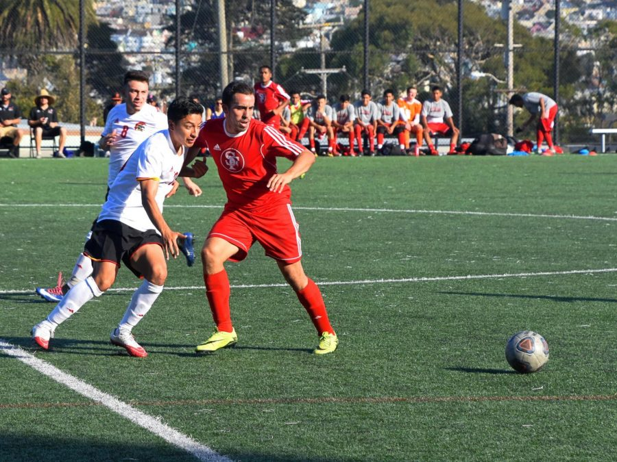 Isai Flores and a City College of San Francisco defender compete for control of the ball on Oct. 24, 2017.